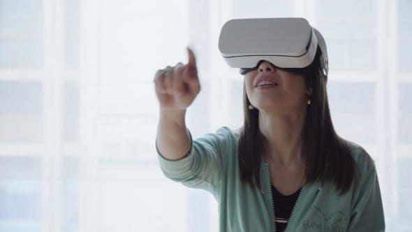Thumbnail for Amazed Woman in Virtual Reality Headset