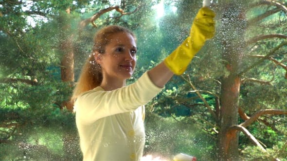 Thumbnail for Young Attractive Woman Cleaning a Window