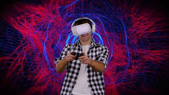 Thumbnail for Man in Virtual Reality Glasses Plays on Computer Graphics Background