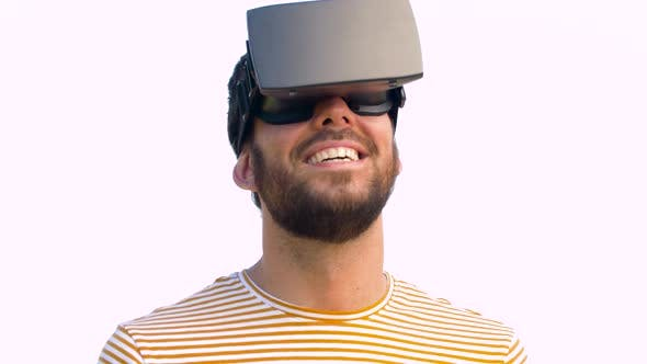Thumbnail for Smiling Man in Virtual Reality Headset Outdoors