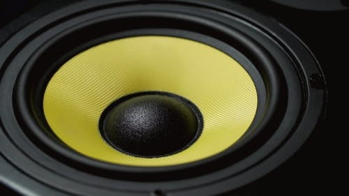 Moving Sub-woofer. Speaker Part. Black and Yellow Colors.