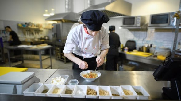 Thumbnail for Professional Male Chef in Uniform and Toque Preparing the Dish for Serving at the Restaurant. Man