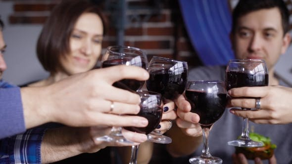 Thumbnail for of Male and Female Hands Clinking Glasses with Red Wine To Each Other with Happy Faces in the