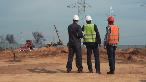 Engineers and Workers on Site