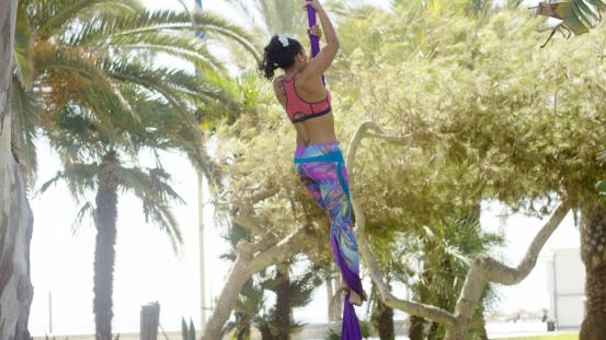 Thumbnail for Female Acrobat Working Outdoors on Silk Ribbons