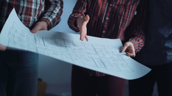 Cover Image for The Group of Designers Discussing Blueprints