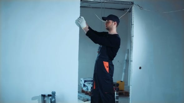 Thumbnail for Builder Taking Measures on Site