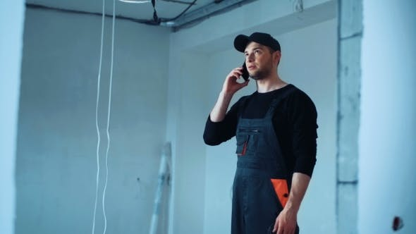 Thumbnail for Man Standing on Site and Talking Phone