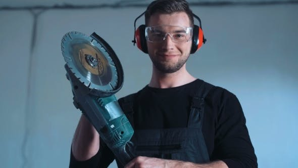 Thumbnail for Smiling Construction Worker with Angle Grinder