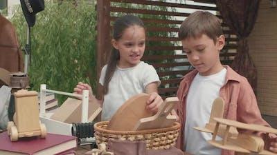 Cute Siblings Preparing for Garage Sale
