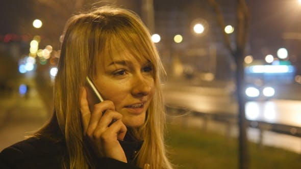 Thumbnail for Young Woman Talking on the Phone in the Evening Outdoor