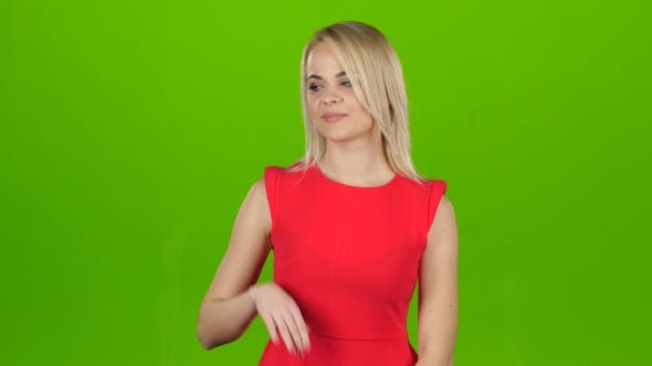 Thumbnail for Girl in Red on Green Screen Background Shows Her Hand
