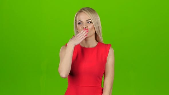 Thumbnail for Blonde in a Red Dress Gives Out Kisses. Green Screen