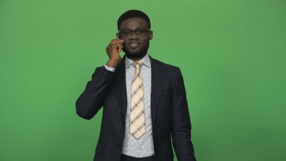 Cover Image for Young African Man Answering Phone Call