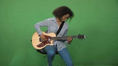 Black Woman Playing Guitar