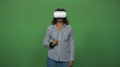 Black Female Using VR Glasses