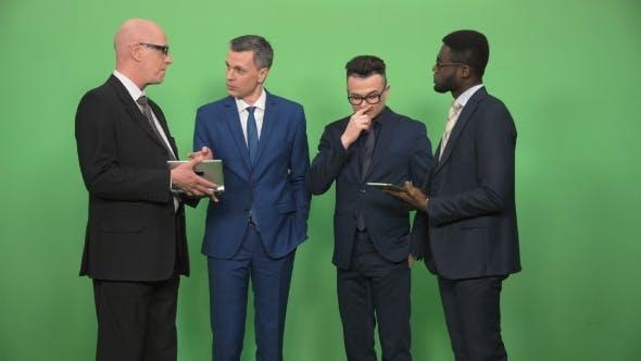 Thumbnail for Four Businessmen Having Conversation