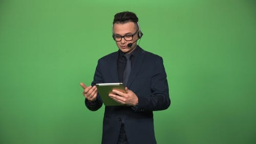 Newscaster with Tablet and Headset