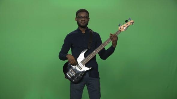 Black Man Playing Guitar
