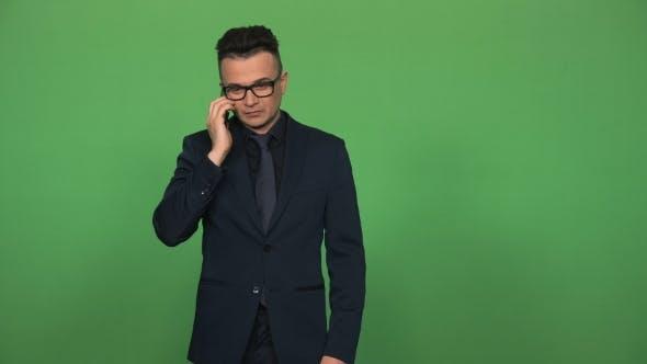 Thumbnail for Young Man Answering Phone Call