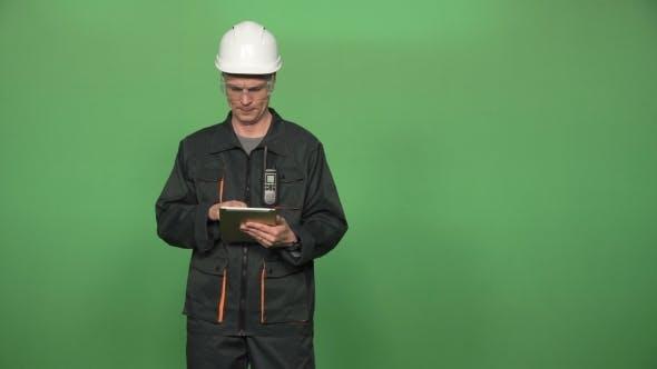 Thumbnail for Engineer Using Digital Tablet