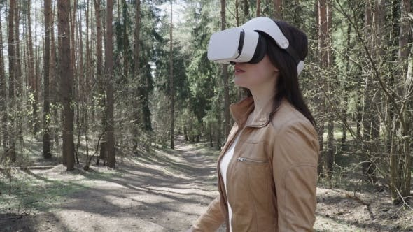 Thumbnail for Woman in Head-mounted Display in the Forest