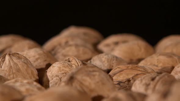 Thumbnail for A Lot of Walnuts, on Black, Rotation, Close Up