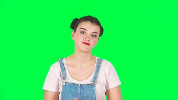 Thumbnail for Displeased Woman Indignantly Talking To Someone, Looking at the Camera, Slow Motion