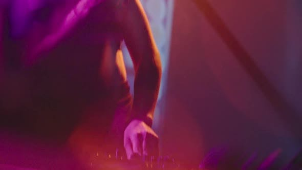 Thumbnail for Woman DJ Dancing and Playing Music in Nightclub