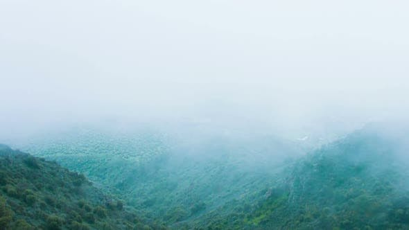 Dangerous Stormy Weather, Humidity, Thick Fog in Mountains. Risky Expedition