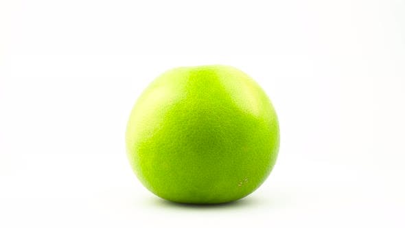 Thumbnail for One Whole Green Sweetie Fruit. Rotating on the Turntable. Isolated on the White Background. Close-up