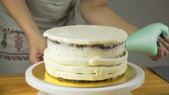 Thumbnail for Confectioner Decorates the Cake and Cover It with Butter Cream. Confectionery Tools: Spatula for