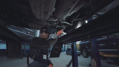 Low Angle View of Black Auto Mechanic