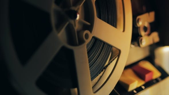 Thumbnail for Old 8Mm Film Projector Playing in the Night.  of a Reel with a Film.