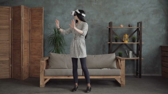 Thumbnail for Woman in VR Headset Touching Virtual Space with the Hands