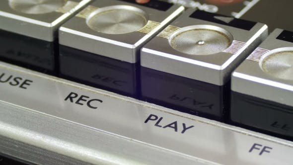 Thumbnail for Pushing Play Button on a Vintage Tape Recorder