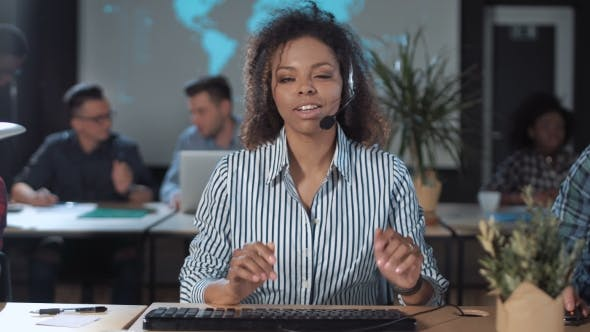 Cover Image for Cheerful Call Center Operator at Work