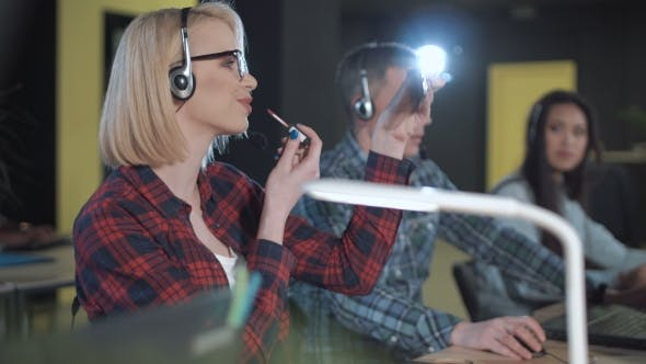 Thumbnail for Woman Applying Lipstick in Call Center
