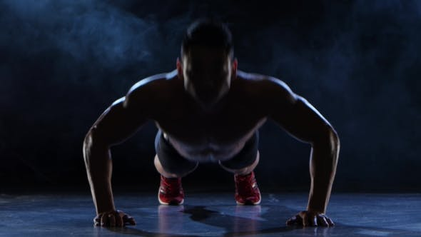 Thumbnail for Asian Muscular Man Push Ups. Black Smoke Background. Silhouette