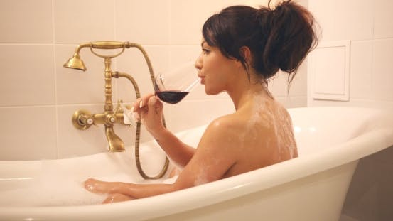 Cover Image for Woman Drinking Wine in Bath