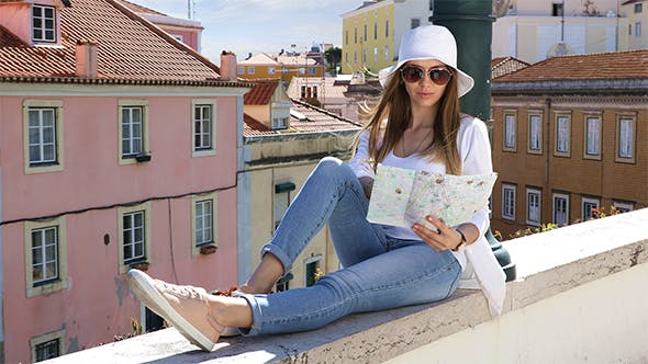 Tourist Girl Sees a Map