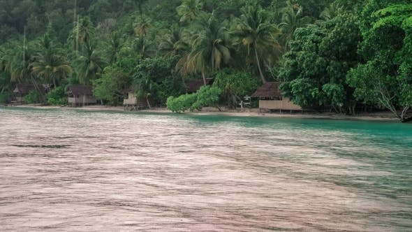 Tropical Rain Over the Bamboo Homestay Huts on the Beach, Gam Island, Raja Ampat, West Papua