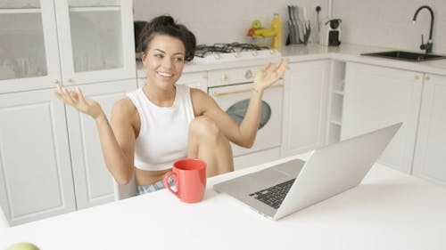 Expressive Young Woman with Laptop