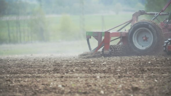 Thumbnail for Harrows Cultivating Field