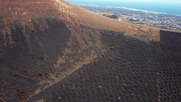 Thumbnail for Flying Over Wine Valley of La Geria, Lanzarote, Canary Islands, Spain