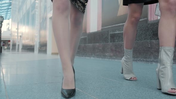 Thumbnail for Legs of Two Girls in Fashion Dresses Walking