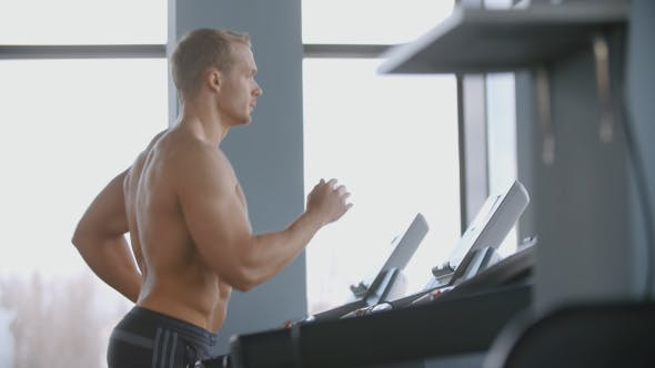 Thumbnail for Muscular Man Running On A Treadmill In The Gym