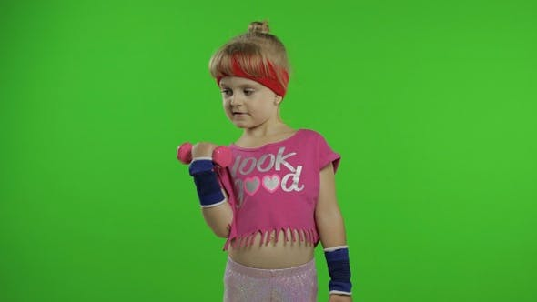 Thumbnail for Caucasian Girl in Sportswear Making Exercises with Dumbbells. Workout for Kids. Athletic Child