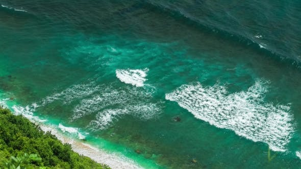 Thumbnail for Aerial View of Waves Rolling One By One To the Nunggalan Beach Near Uluwatu, Bali, Indonesia