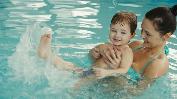 Thumbnail for Mother with Her Baby Have Fun in the Pool